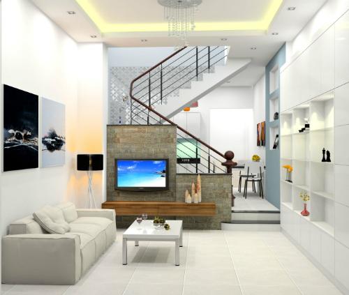 ti vi kết hợp vách ngăn cầu thang làm điểm nhấn chính cho phòng khách.
